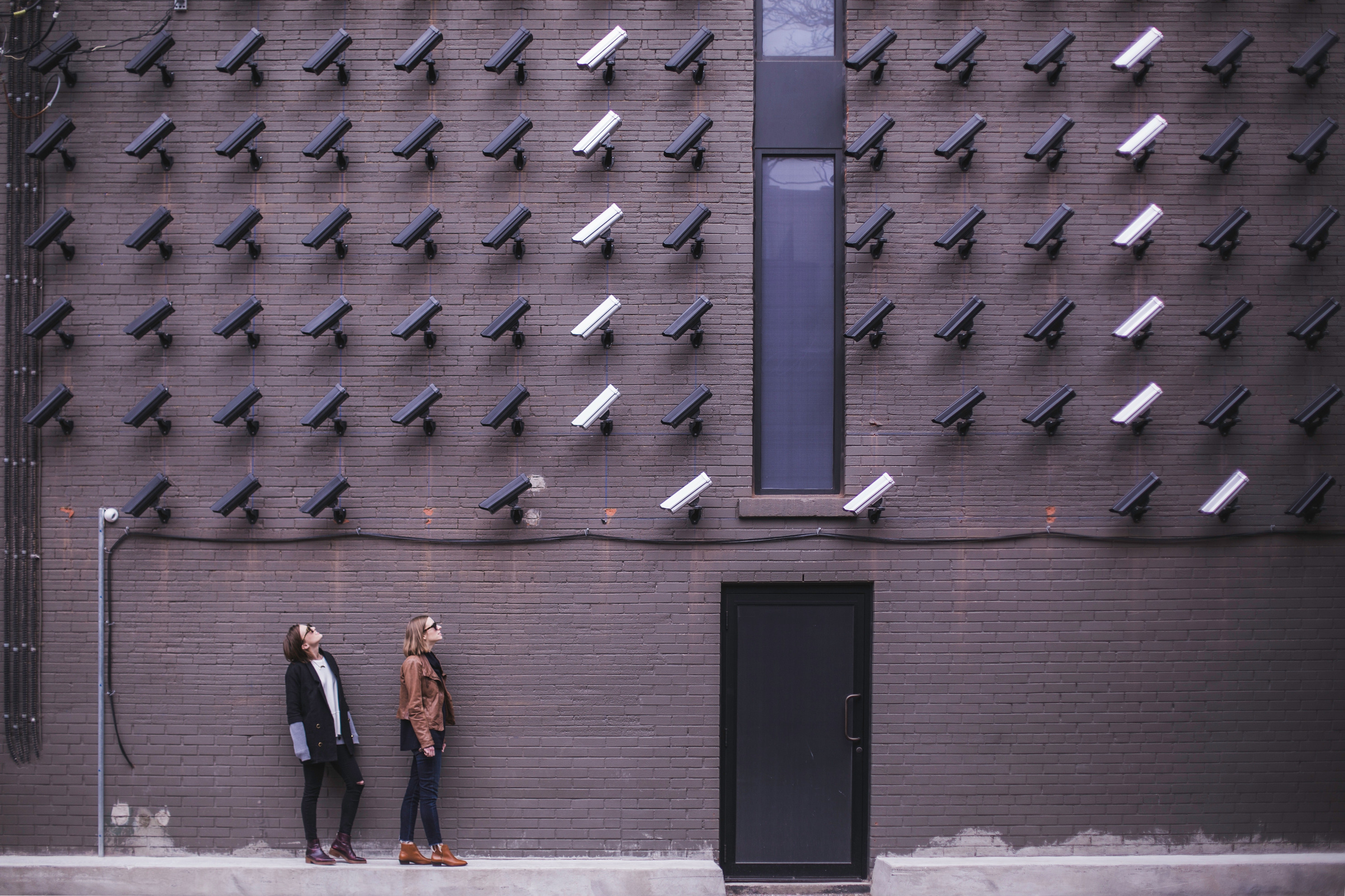 a picture showing a wall of CCTV